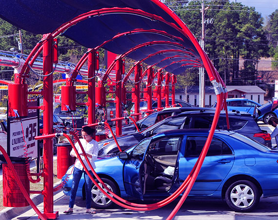 Cars at a car wash using the vacuums